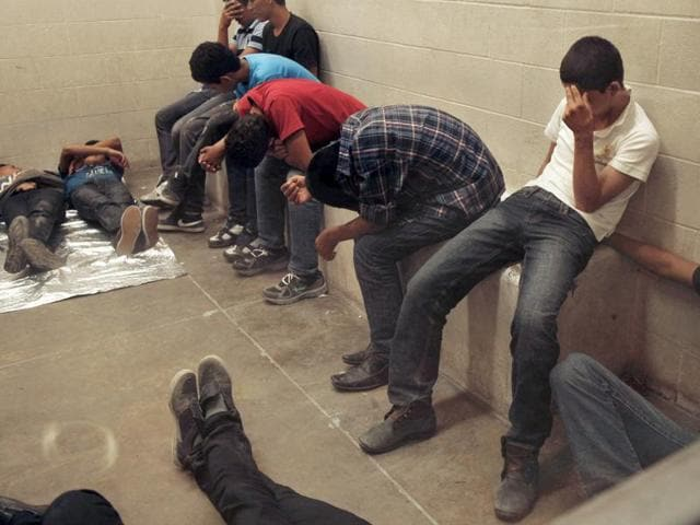 Immigrants who have been caught crossing the border illegally are housed inside the McAllen Border Patrol Station in McAllen, Texas. The Obama administration is intensifying its efforts to expel migrants from Central America, many of whom are fleeing the extreme violence of their home countries.