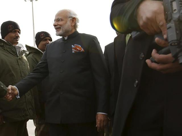 India's Prime Minister Narendra Modi shakes hands with the members of the Indian air force at Kabul international airport, Afghanistan December 25, 2015. REUTERS/Mohammad Ismail
