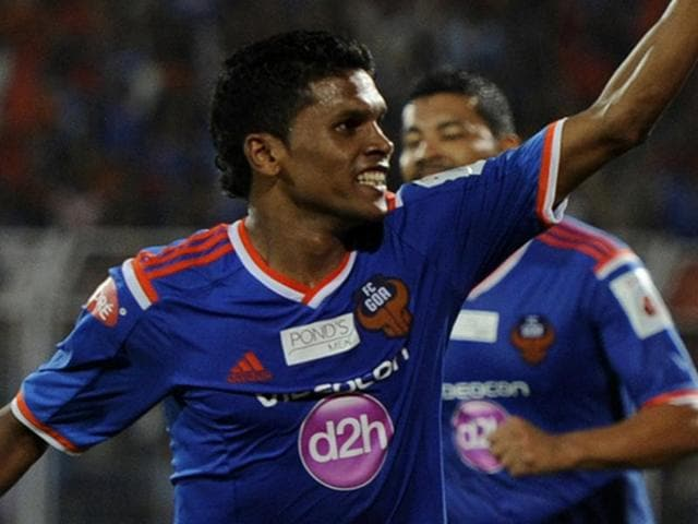 Romeo Fernandes of FC Goa runs to celebrate a goal during match 46 of the Hero Indian Super League between FC Goa and North East United FC held at the Jawaharlal Nehru Stadium, Fatorda.
