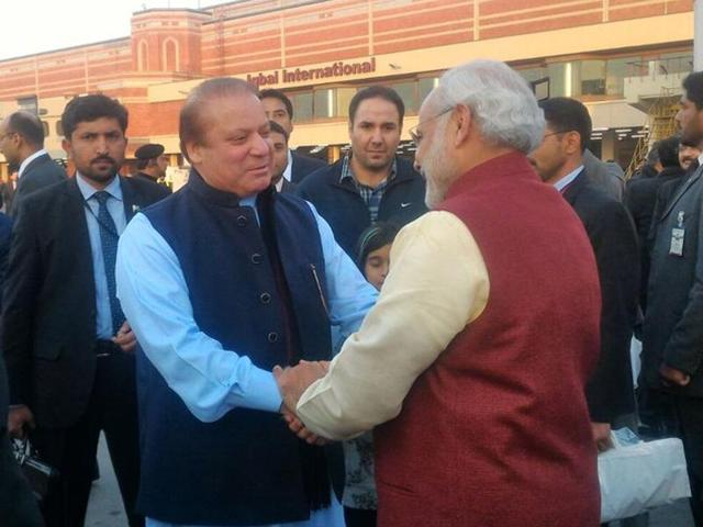 Pakistan PM Nawaz Sharif welcomes PM Narendra Modi at Lahore airport. Modi is visiting Pakistan on Sharif's birthday on Friday on his way from Kabul to Delhi.(Twitter/@MEAIndia)