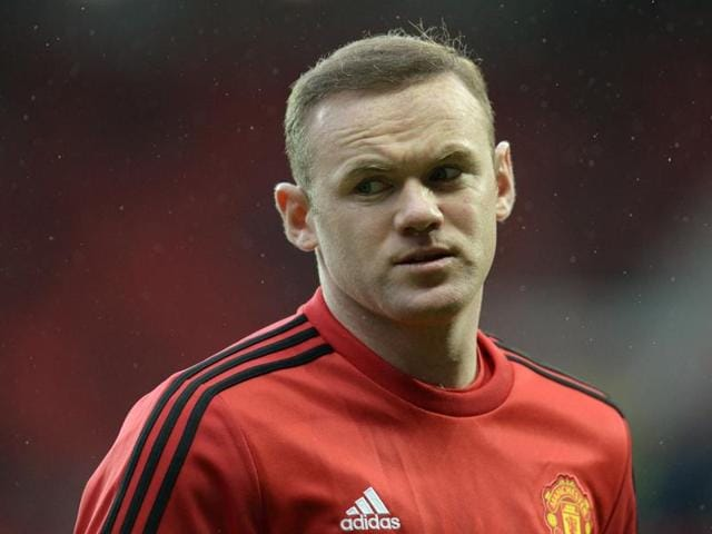 Manchester United's Wayne Rooney warms up before the game against Stoke City.(Reuters Photo)