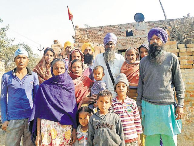 Sukhdev Singh with his family who were boycotted by the upper caste landlords at Burj Dhilwan village in Mansa district on Friday.