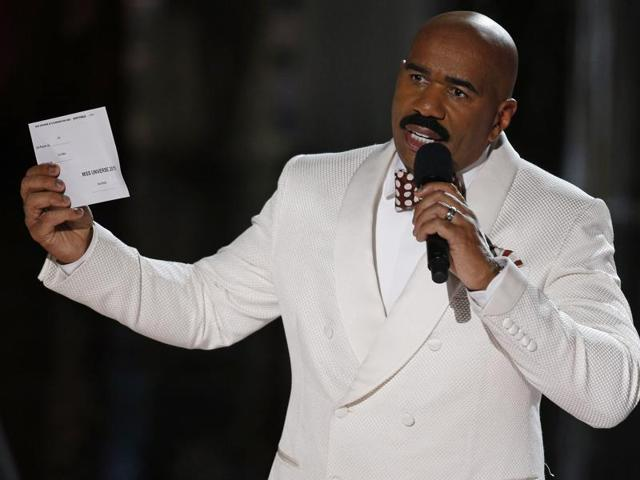 Steve Harvey holds up the card showing the winners after he incorrectly announced Miss Colombia Ariadna Gutierrez at the winner at the Miss Universe pageant Sunday, Dec. 20, 2015, in Las Vegas.  But on Christmas day, poking fun at himself, Harvey posted 'Merry Easter' on his various social media accounts.
