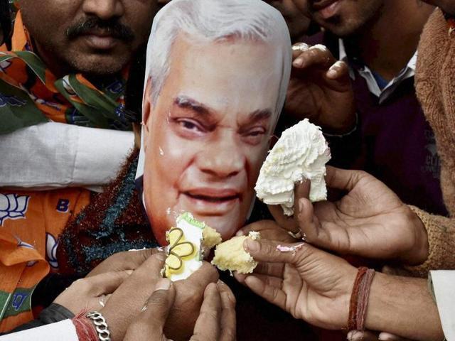 BJP activists celebrating former PM Atal Bihari Vajpayee's birthday in Patna on Friday. PM Modi visited Vajpayee's residence on Friday night to wish him.(PTI)