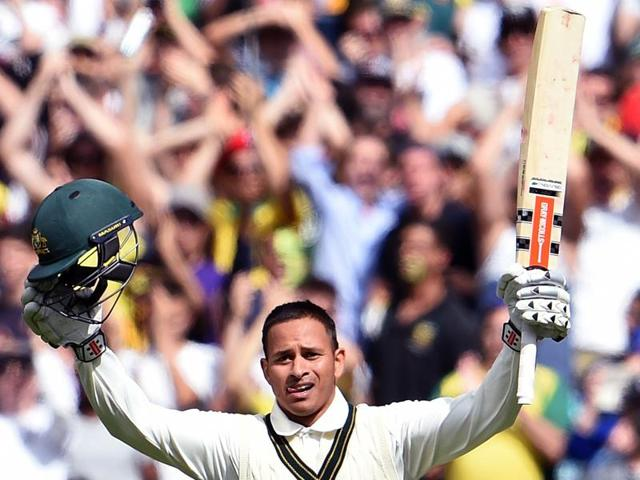 Australian batsman Joe Burns celebrates scoring his century against the West Indies on the first day of the second cricket Test in Melbourne on December 26, 2015.(AFP Photo)