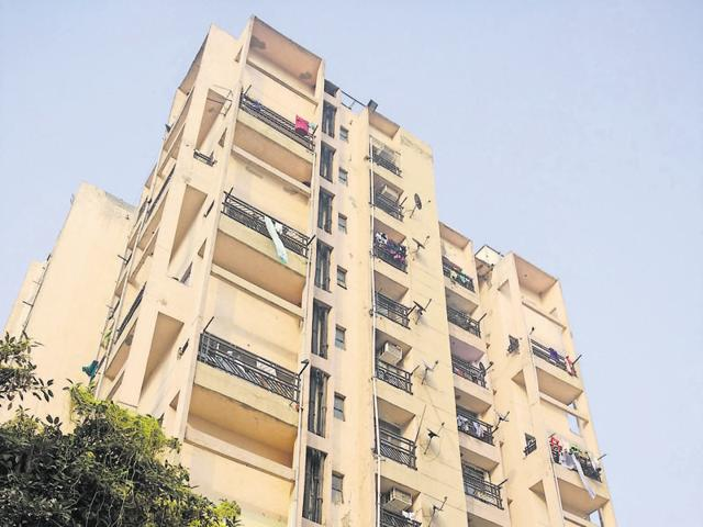 The four people stuck were rescued only after other residents of the building forced open the lift doors.