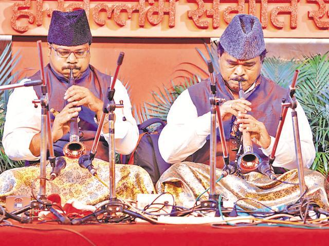 Shehnai maestros Pandit S Ballesh (right) and his son, Krishna Ballesh, during the 140th Harivallabh Sangeet Sammelan in Jalandhar on Friday.