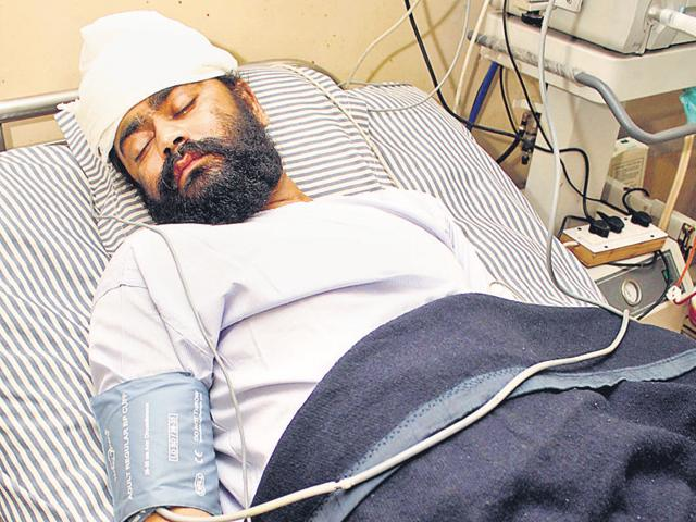 Jagmohan undergoing treatment at a private hospital in Jalandhar. He had suffered serious injuries in left ear and hand.