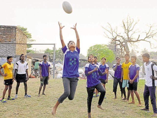 Boys and girls playing Rugby at Dhapa, in Kolkata India .