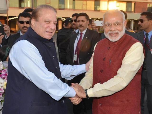 In this photo released by Press Information Department, India's Prime Minister Narendra Modi, right, shakes hands with his Pakistani counterpart Nawaz Sharif in Lahore, Pakistan, Friday.