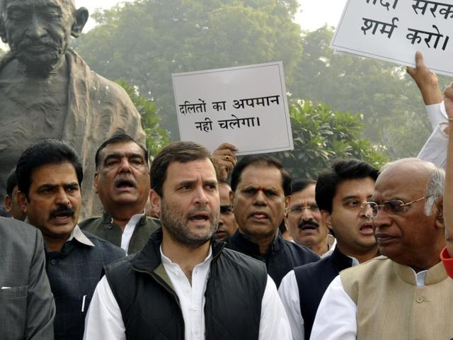 "Congress MPs led by Rahul Gandhi staged dharna outside the Parliament house demanding removal of minister VK Singh for using ""dog analogy"" while commenting on Dalit deaths, in New Delhi, India, on Monday, December 7, 2015."