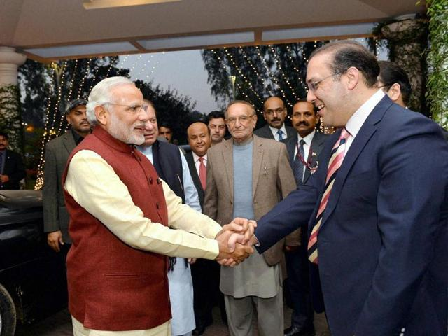 In this photo released by Press Information Department, India's Prime Minister Narendra Modi, right, shakes hands with his Pakistani counterpart Nawaz Sharif in Lahore, Pakistan(AP)
