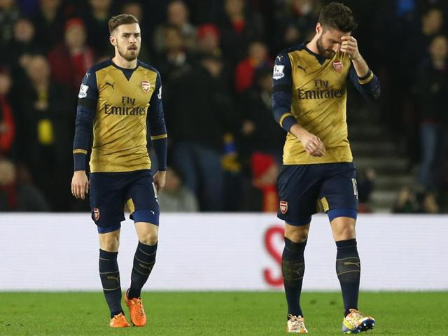 From left to right, Arsenal's Per Mertesacker, Alex Oxlade Chamberlain, Nacho Monreal and Laurent Koscielny look dejected after Jose Fonte scored the third goal for Southampton during their EPL game at St. Mary's Stadium on December 26, 2015.