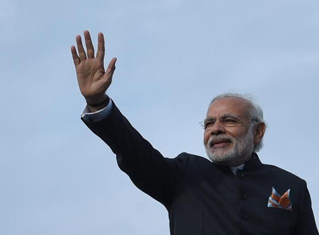 Prime Minister Narendra Modi waves as he boards an aeroplane at the Kabul International Airport.