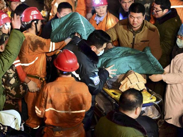 A trapped miner is rescued from a collapsed gypsum mine in Pingyi County, east China's Shandong Province.