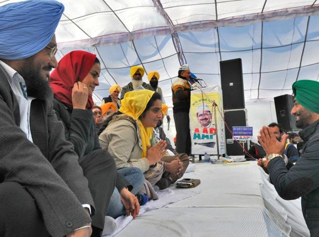 Newly joined AAP leader Sukhpal Singh khera interacting with AAP leaders during the AAP rally at Saheedi Jode mela at dist Fatehgarh in Punjab on Sunday.