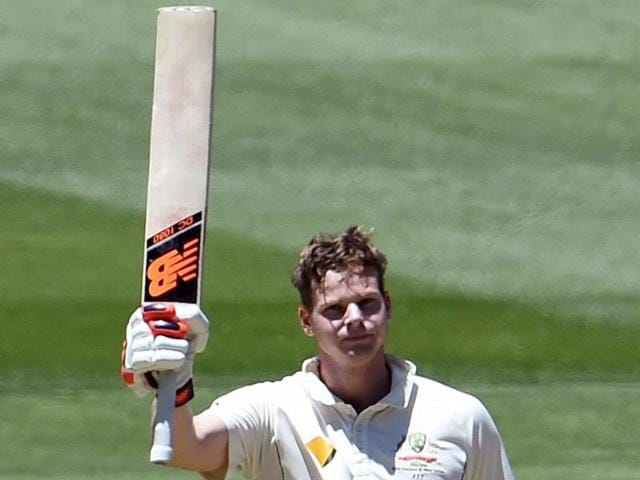 Adam Voges celebrates scoring his century against the West Indies on the second day of the second Test match in Melbourne on December 27, 2015.(AFP Photo)