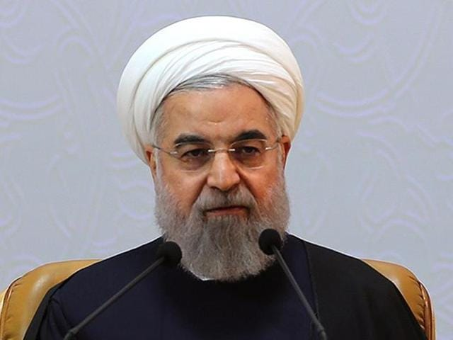 Iran's President Hassan Rouhani, who is also a member of the Experts Assembly speaks with media in a press briefing after registering his candidacy.