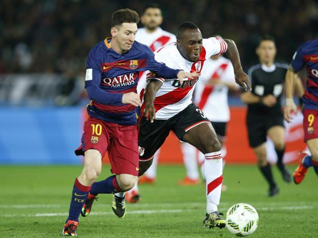 FC Barcelona's Lionel Messi fights for the ball with River Plate's Gabriel Mercado during their final match at the FIFA Club World Cup soccer tournament in Yokohama, near Tokyo.