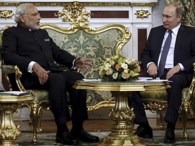 Russia's President Vladimir Putin (L) shakes hands with India's Prime Minister Narendra Modi during a meeting at the Kremlin in Moscow.