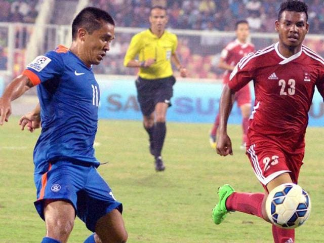Indian and Nepal's players in action during their SAFF Suzuki Cup 2015 match in Thiruvananthapuram.