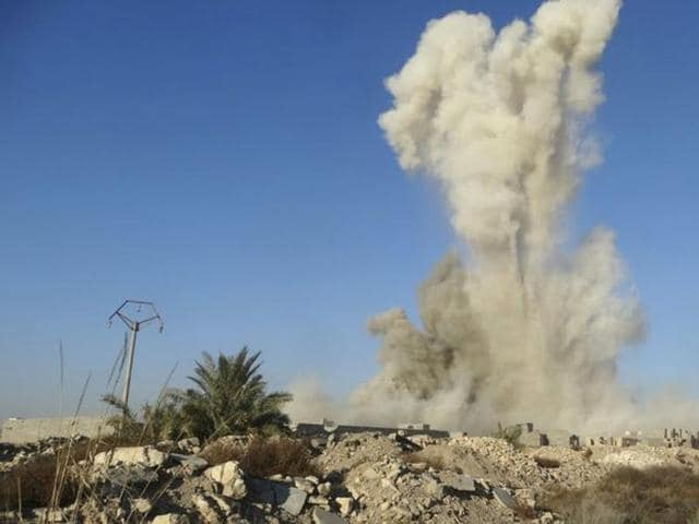 Smoke rises after an air strike in Ramadi city.