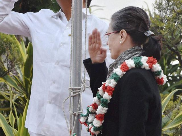 Congress president Sonia Gandhi hoisting the party flag at the party's 131st foundation day function at AICC headquarters in New Delhi.
