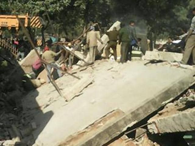 Rescue operation on after roof of a liquor shop collapsed in Sector 26, Chandigarh.