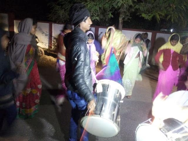 Tribals beat drums outside Betul collector's official residence.