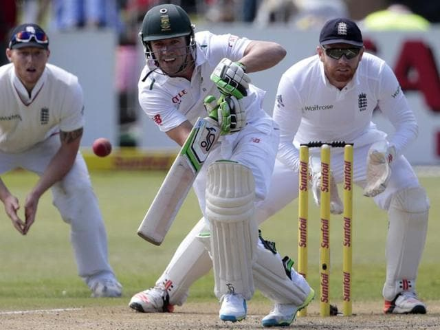 AB de Villiers (C) plays a shot on the second day of the first Test match between South Africa and England at Kingsmead Stadium in Durban on December 27, 2015.