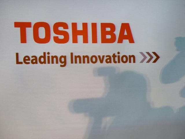 A Toshiba logo is seen during a press conference at their headquarters in Tokyo.(AFP)
