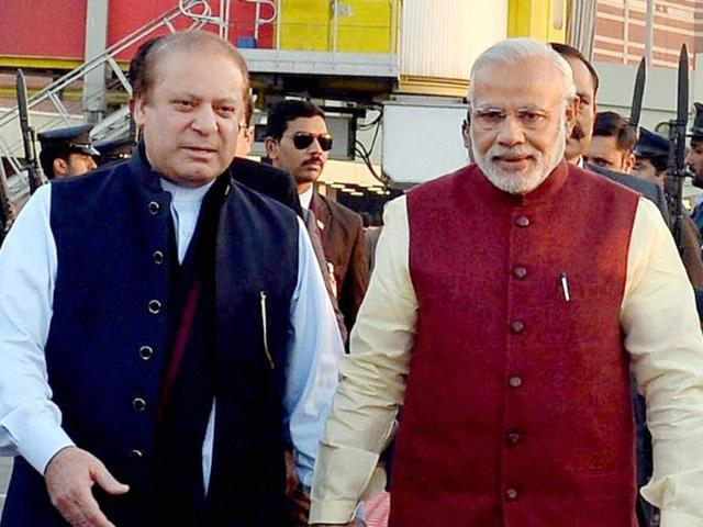 In this photo released by Press Information Department, India's Prime Minister Narendra Modi, right, shakes hands with his Pakistani counterpart Nawaz Sharif in Lahore, Pakistan, Friday, Dec. 25, 2015.