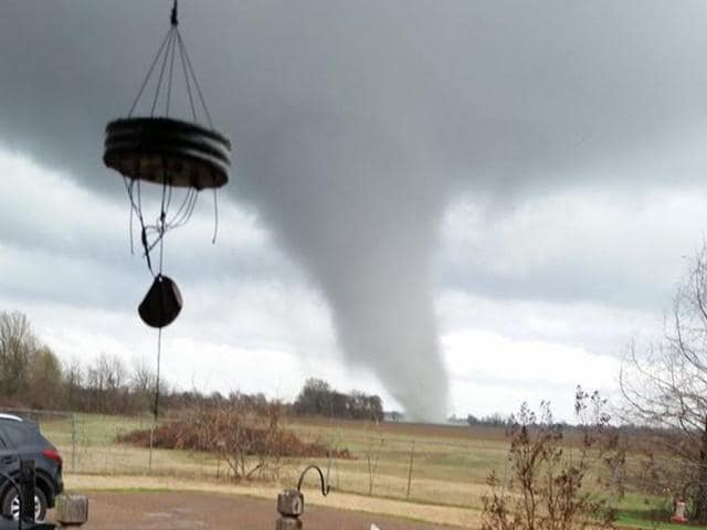 A photo posted on Twitter shows a tornado touches down in south of Clarksdale, Mississippi. At least 11 people lost their lives as tornadoes tore through Texas, authorities said.