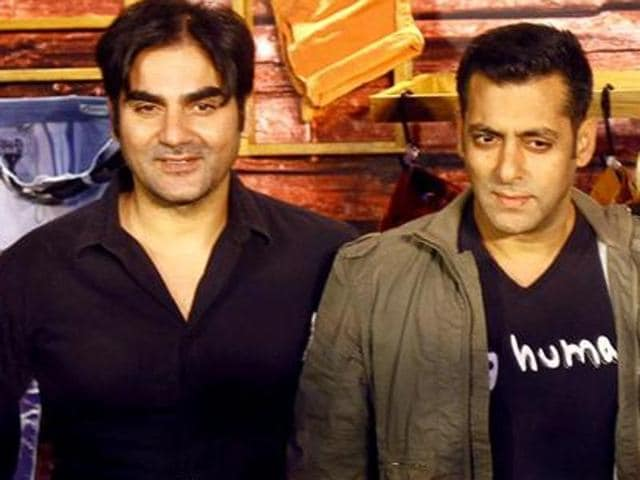 Salman Khan poses with brothers Arbaaz and Sohail during the launch of Being Human flagship store in Mumbai.