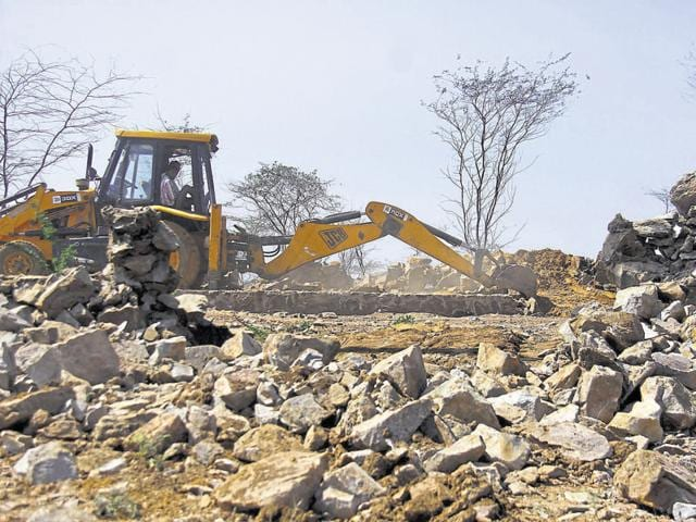 A demolition drive on illegal construction in Raisina village in the Aravalli forests.