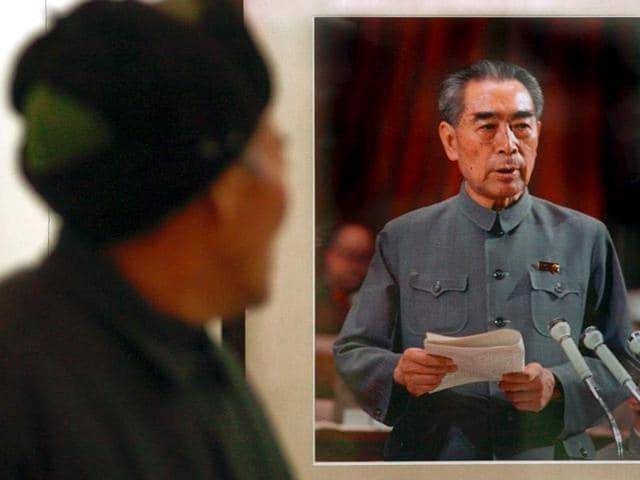 A man looks at a picture of the late Chinese Premier Zhou Enlai at a photo exhibition.