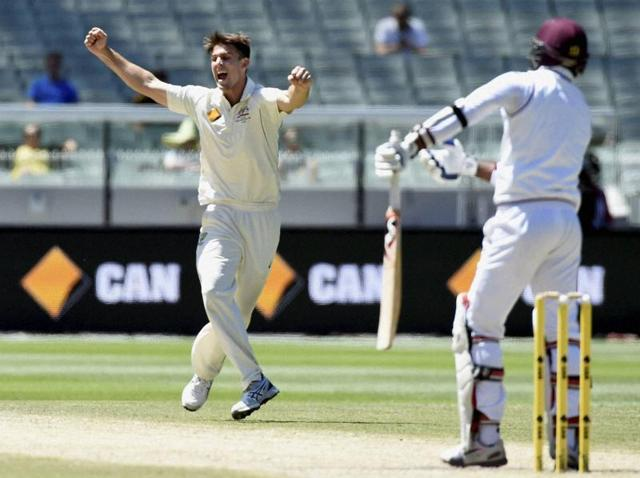 Australia's Mitchell Marsh celebrates capturing the wicket of West Indies' Marlon Samuels during their cricket test match in Melbourne, Australia.