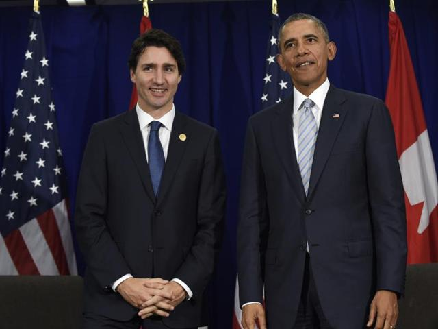 US President Barack Obama and Canadian Prime Minister Justin Trudeau stand up following their bilateral meeting at the Asia-Pacific Economic Cooperation summit in Manila, Philippines. The White House says Trudeau will attend a state dinner on March 10 in a visit intended to boost ties between the neighbouring countries.