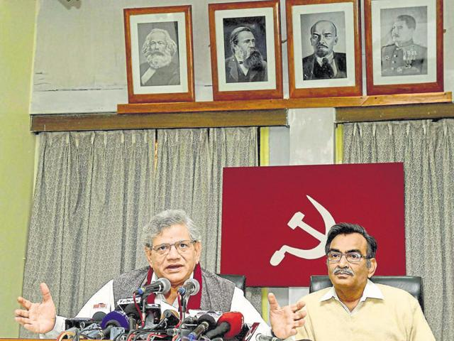 CPI(M) activists hold flags and huge party symbol in an open rally at Brigade Parade Ground in Kolkata on Sunday.