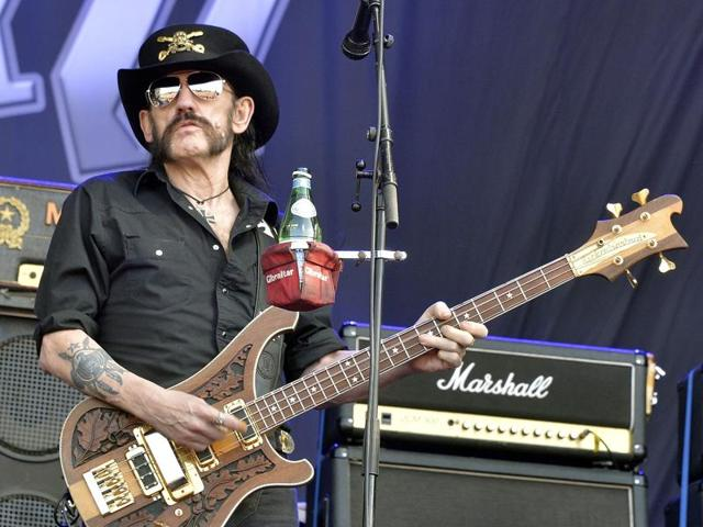 This file photo taken on June 19, 2015 shows Motorhead's singer and bassist, Ian Lemmy Kilmister, performing during the Hellfest heavy metal and hard rock music festival Hellfest in Clisson, near Nantes, western France. Ian Lemmy Kilmister, the frontman of iconic British heavy metal band Motorhead, has died aged 70 of a sudden, aggressive cancer, the group said on December 29, 2015.