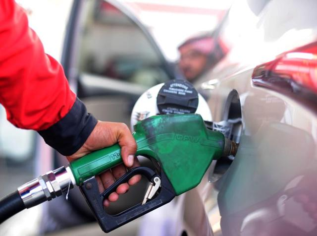 A Saudi employee fills the tank of his car with petrol at a station on Monday in the Red Sea city of Jeddah. The Saudi council of ministers decided to raise the price of higher-grade unleaded petrol to 0.90 riyals ($0.24) per litre from 0.60 riyals, a hike of 50%, and for lower-grade petrol to 0.75 riyals ($0.20) from 0.45 riyals per litre, a 67% rise.