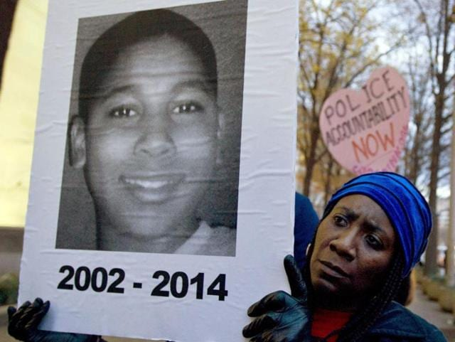 Barricades were set up outside the county courthouse in Cleveland in case of protests, and about two dozen people gathered in the cold rain at the recreation center where Tamir was shot, some holding signs with photos of the boy and others killed by police in the US.