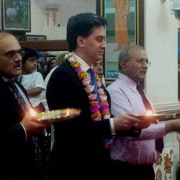 Former Labour leader Ed Miliband sporting a 'tilak' and holding a pooja thali during 'arti' in a London temple.