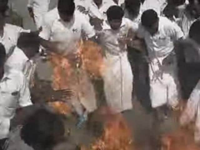 The AIADMK worker was trying to burn an effigy of DMDK chief and Tamil film actor Vijayakanth.