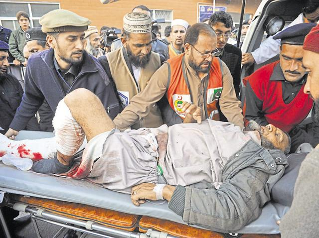 A bomb blast victim being taken to a hospital in Peshawar by paramedics on Tuesday
