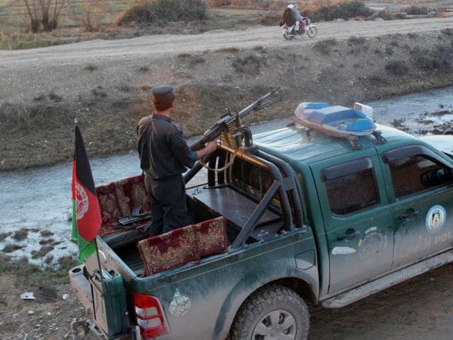 Afghan police patrol in Lashkar Gah, capital of Helmand province, Afghanistan. The AQIS camp, described by military officials as one of the largest ever discovered, was attacked by American and Afghan commandos in October, backed by several US airstrikes.