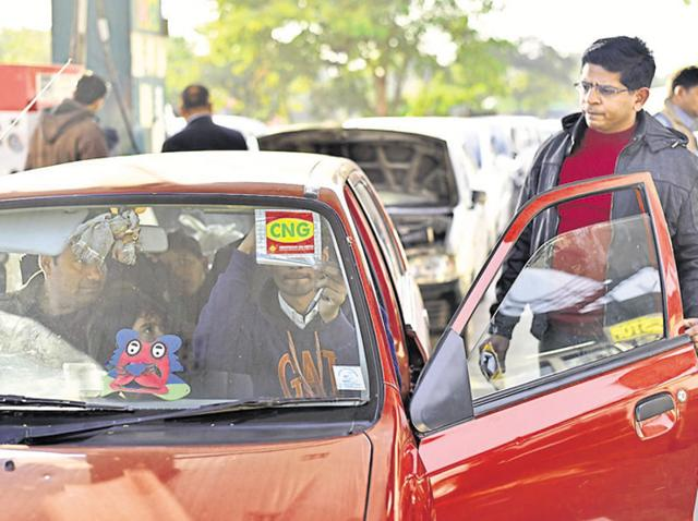 Delhiites line up to get CNG stickers for their vehicles. Cars that run on the cleaner fuel are exempt from the odd-even rule.