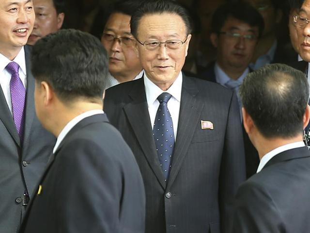 In this Oct. 4, 2014 file photo, Kim Yang Gon, center, a secretary of North Korea's ruling Workers' Party, arrives at the Incheon International Airport in Incheon, South Korea.  Gon, in charge of relations with South Korea,  died of a car accident, the Korean Central News Agency announced Wednesday, Dec. 30, 2015.