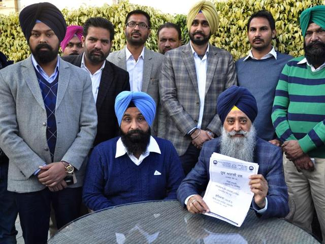 Punjab minister Sharanjeet Singh Dhillon showing the list of SAD youth body at his residence in Ludhiana on Wednesday.(Sikander Singh Chopra/HT)