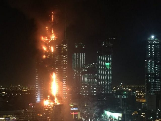 A huge fire ripped through a luxury Dubai hotel on Thursday near the world's tallest tower, where people were gathering to watch New Year's Eve celebrations.